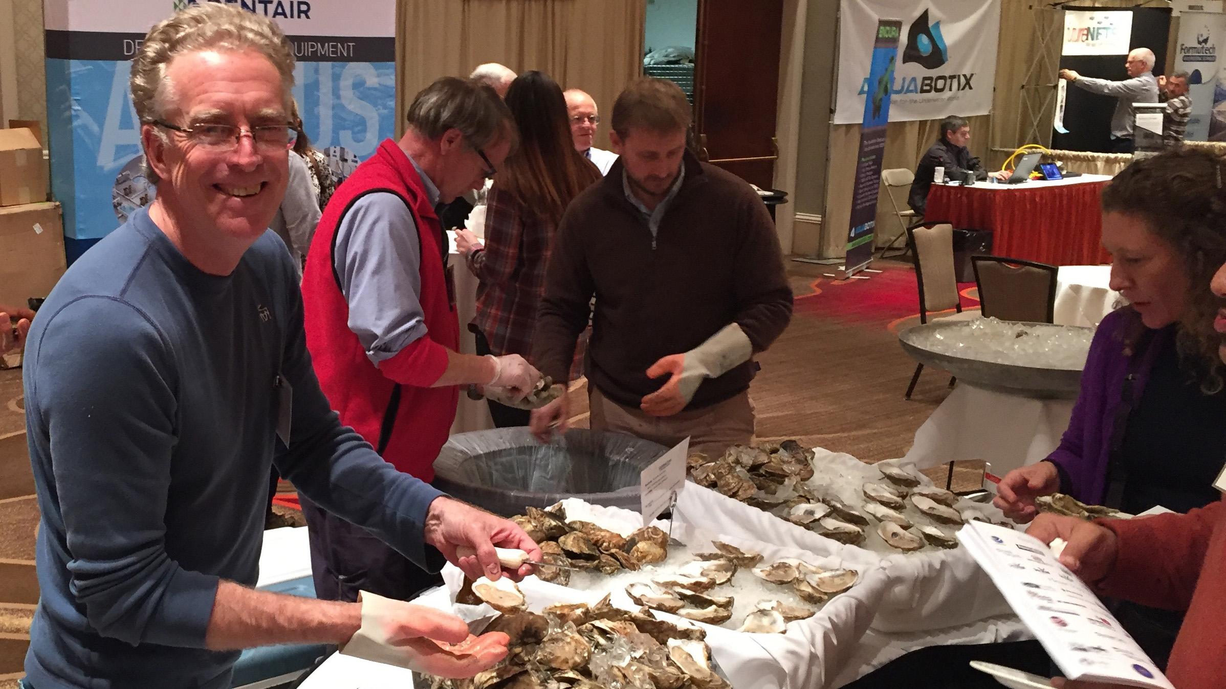 Davis Archer, Bob Rheault and Seth Garfield oyster