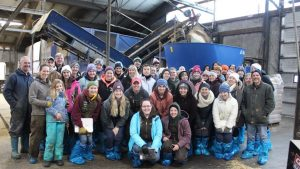umaine students visiting a dairy during a travel course