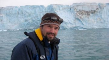 Seth Campbell in front of glacier