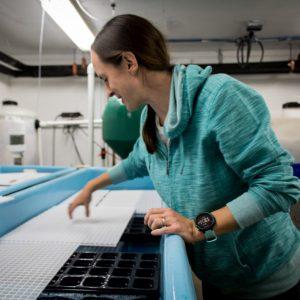 Portrait of Amalia Harrington working in a laboratory.