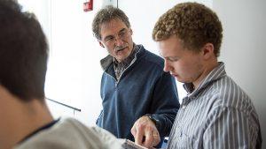 Paul Rawson helping a student