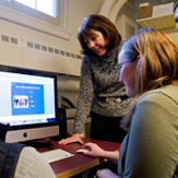 Student with professor learning to use speech pathology telepractice system